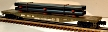 "Atlas-O 0944-1 U.S. Army (DODX) 52'-6"" Flatcar with Pipes Load"